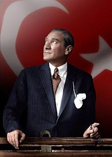 220px-mustafa_kemal_ataturk_looking_through_a_train_window_over_turkish_flag